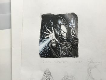 Eldar Warlock shooting energy from his palm.jpg