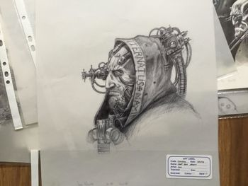 Tech Priest with eye and cranial augmentation.jpg