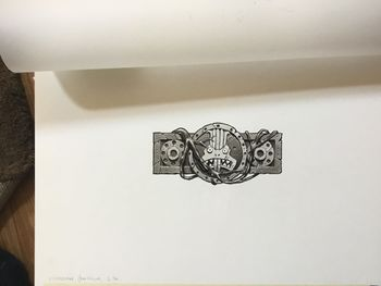 Lizardmen emblem - stone and vine.jpg